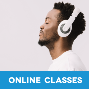 man with headphones on is smiling peacefully